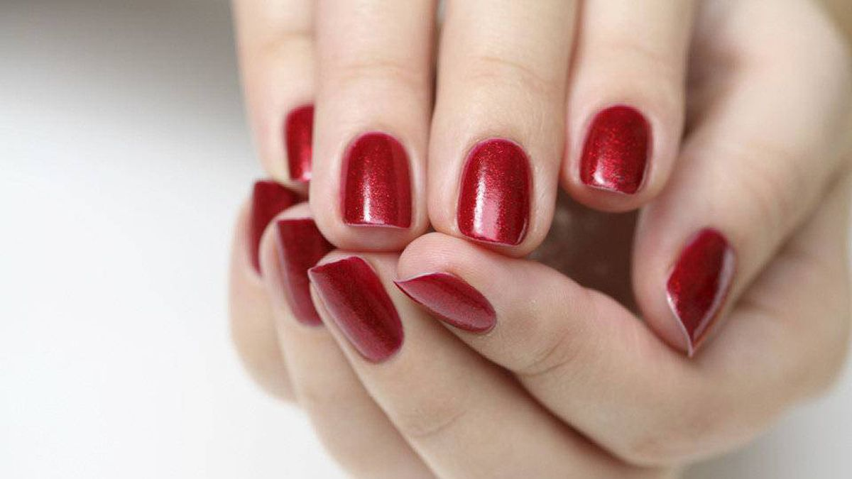 The polish colours of the season have a festive feel, says Revlon nail expert Leeanne Colley. 'Definitely reds and deeper, warmer tones.' She suggests taking a light, metallic colour and brushing it on the tip of your nails, creating a fade effect 'to jazz it up a little.'