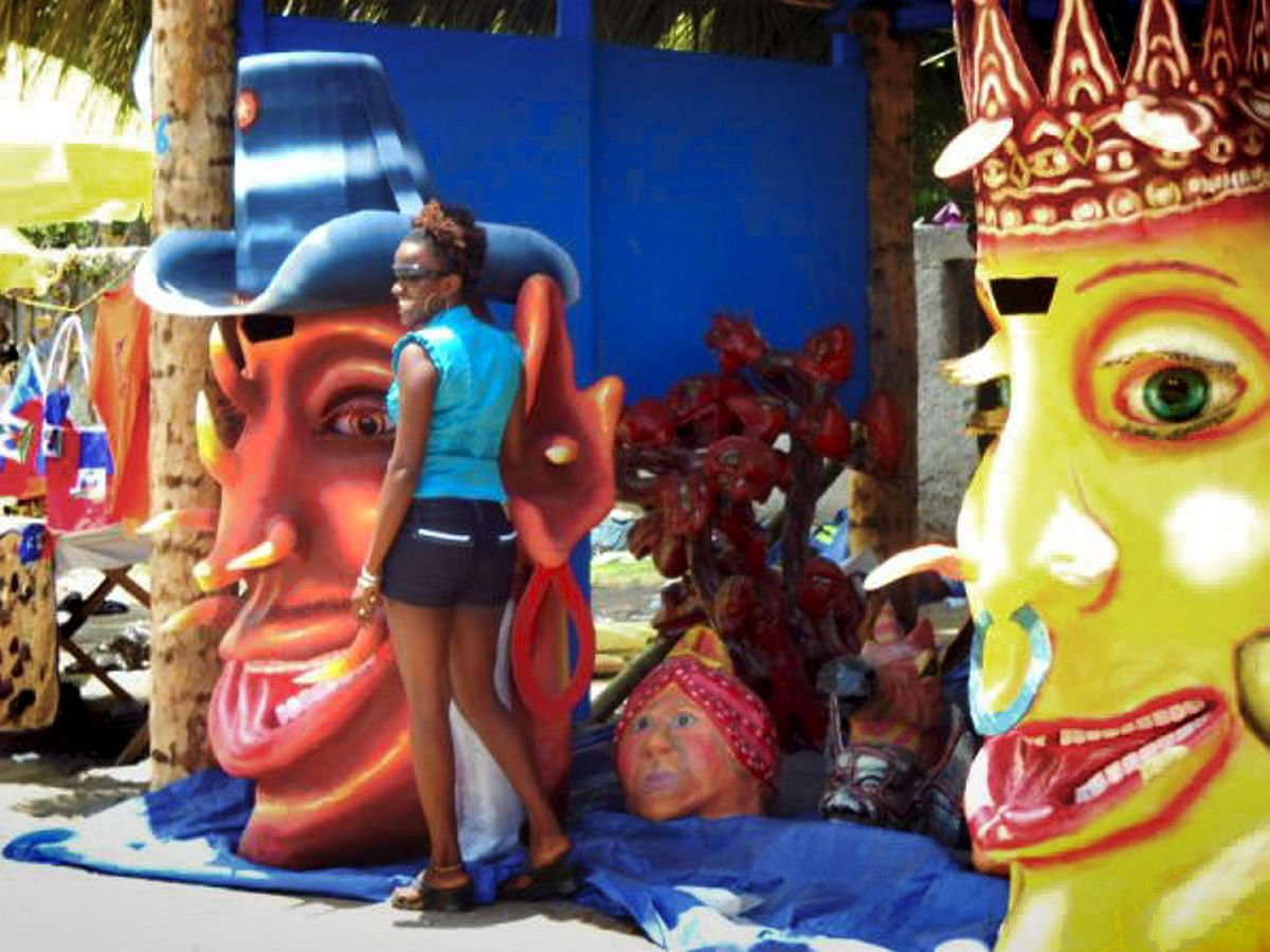 People celebrate at an art exposition on Congo Beach in Jacmel.