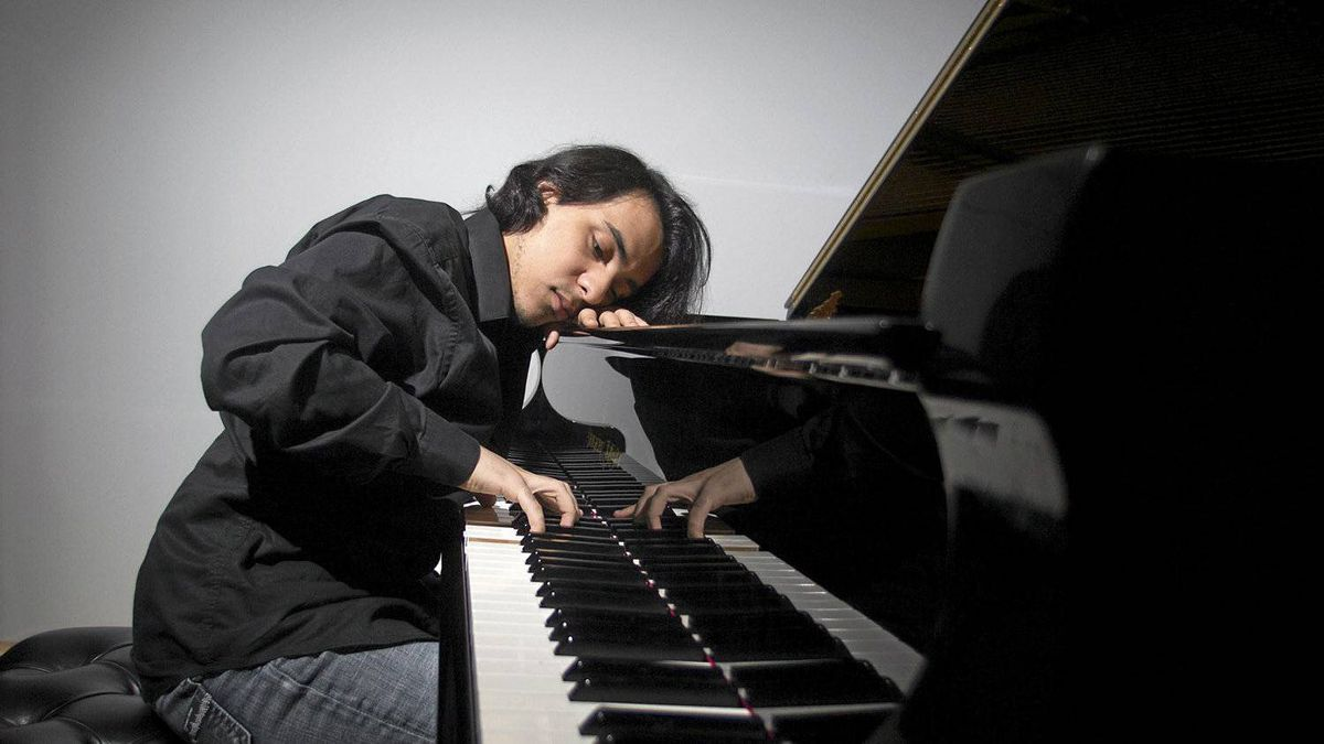Mehdi Ghazi, a pianist from Algeria plays following an interview in Montreal, January 12, 2011. Ghazi was mostly untrained when he was discovered at age 16 by well-known Quebec pianist Alain Lefevre.