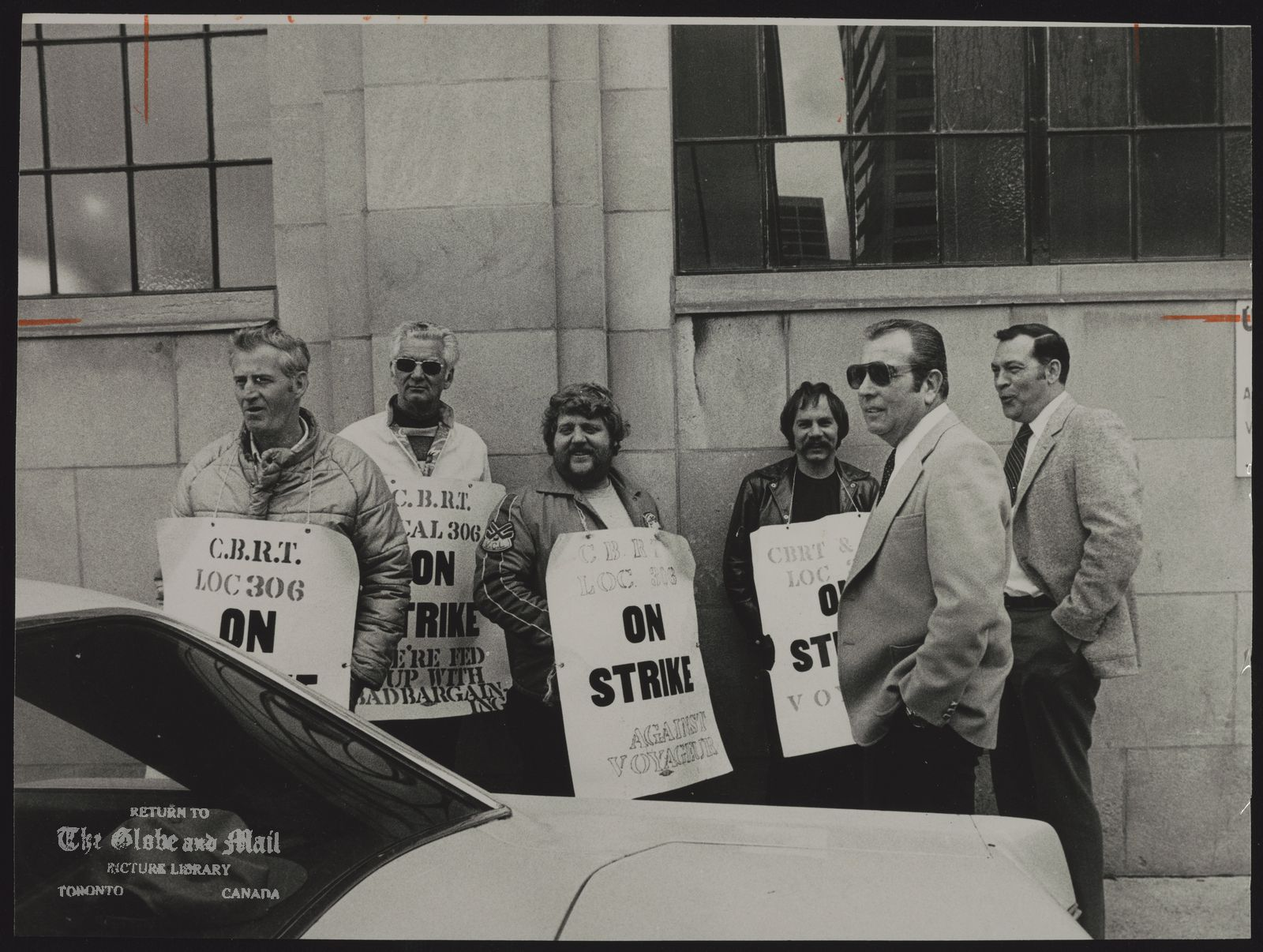 VOYAGEUR COLONIAL LTD. Gordon Grant (right) and Stanley Gayler talk to pickets on strike at Voyageur Colonial Ltd. last month.