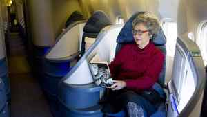 Adrienne Clarkson reads Keith Richards' memoirs in the business class section of a passenger jet at Pearson Airport in Toronto.