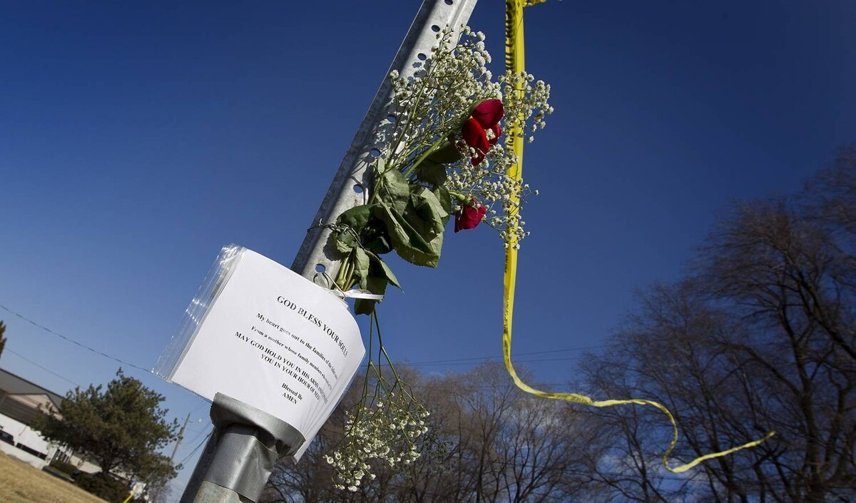 BURLINGTON, ONT. - Feb. 27, 2012 - Some flowers and a note of condolence have been left on a street sign near the scene of yesterday's VIA train derailment. The Via passenger train, enroute from Niagara Falls to Toronto, derailed on Sunday at approximately 3:30pm. Three VIA employees in the engine died as a result if the crash, and many passengers were taken to local hospitals; three with serious injuries. One track has been open and trains have been passing the site all day. (Photo by Peter Power/The Globe and Mail)pmp