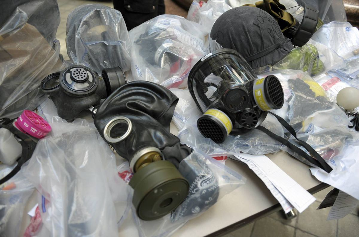 A collection of gas masks seized from G20 summit protesters are displayed during a news conference at Toronto police headquarters on June 29, 2010.