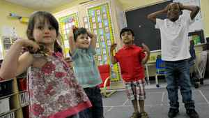 (L-R) Millie Bolton, Alfie Bolton, Prathmesh Mistry and Mekhi Rutherford play games in their classroom, June 4, 2011. (for The Globe and Mail)