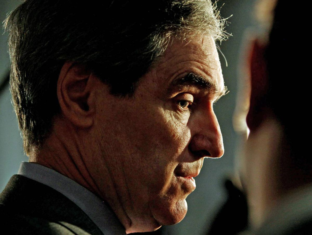 Liberal Leader Michael Ignatieff talks to reporters before attending his national caucus meeting in Ottawa on April 21, 2010.