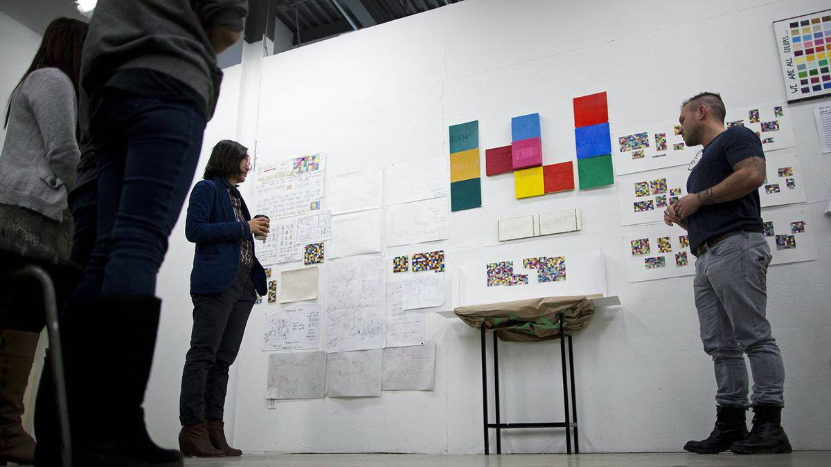 """Ben Garner (right) presents his group's Union Gospel Mission """"What Color are You?"""" project at Emily Carr University of Art and Design in Vancouver, British Columbia, Monday, March 5, 2012."""