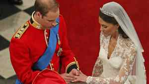 """With this ring, I thee wed."" Prince William places a ring on Kate Middleton's finger before the Archbishop of Canterbury (and tens of millions of viewers) during their wedding ceremony in Westminster Abbey on April 29, 2011."