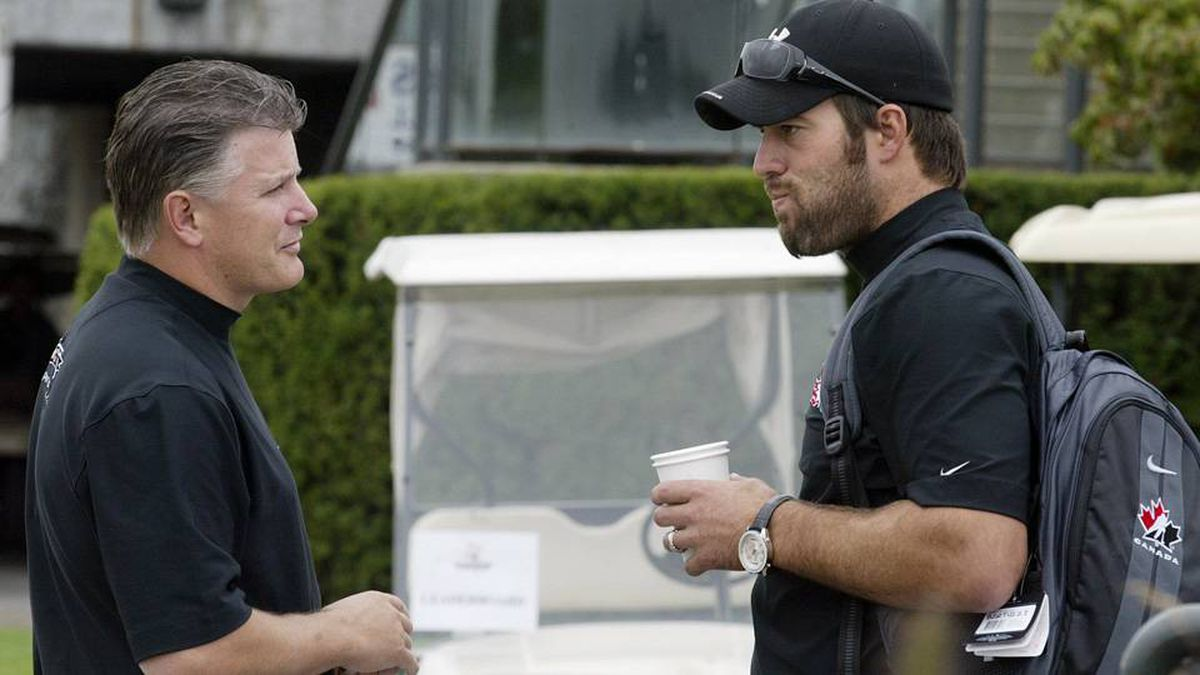 Todd Bertuzzi, right, talks with Marc Crawford prior to the start of a charity golf tournament in Surrey, B.C., Tuesday, Aug. 16, 2005.