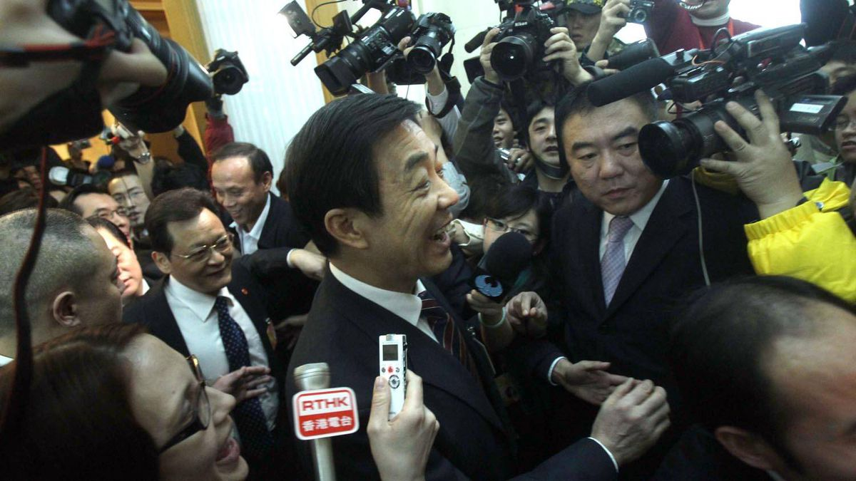 Bo Xilai, governor of Chongqing municipality, is surrounded by microphones and cameras at the National People's Congress in Beijing. AFP/Getty Images