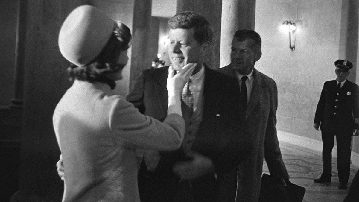 Jacqueline Kennedy has a chuck under the chin for President John F. Kennedy, moments after he became president on Jan. 20, 1961.
