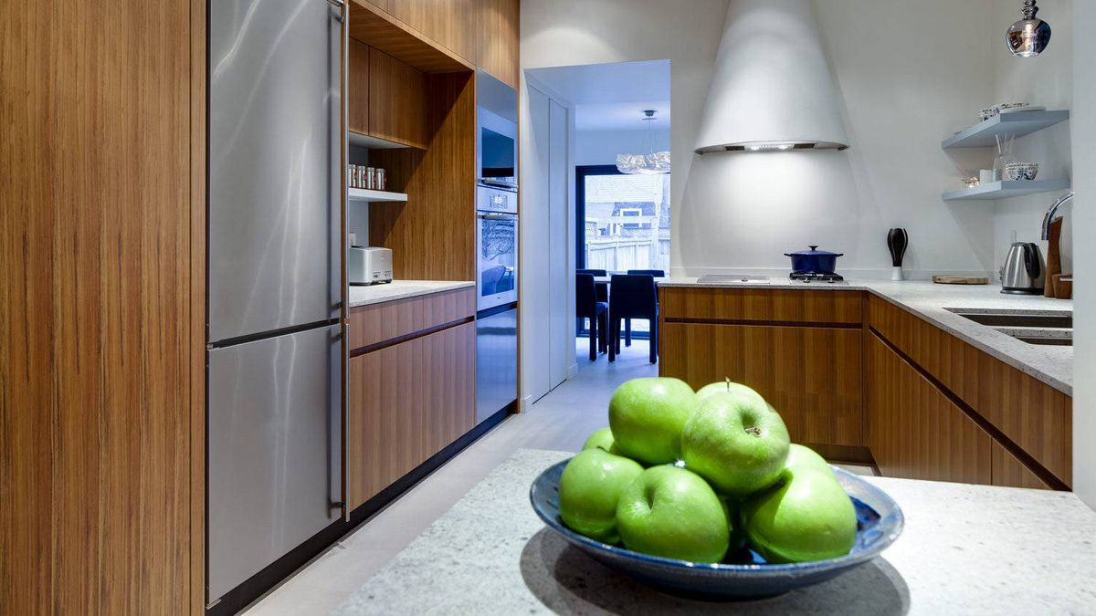 The kitchen benefits from its placement in the middle of the house rather than at one end.
