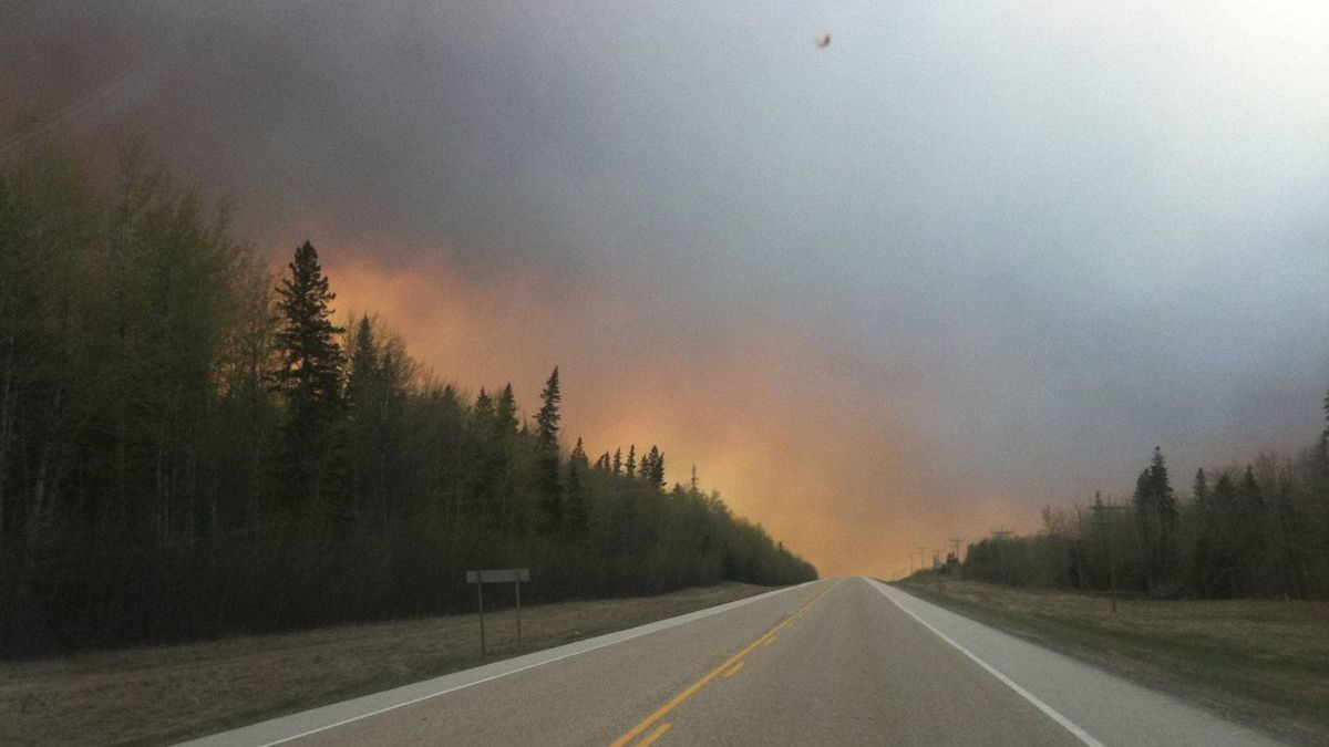 Flames from forest fires near Widewater, Alberta May 15, 2011.