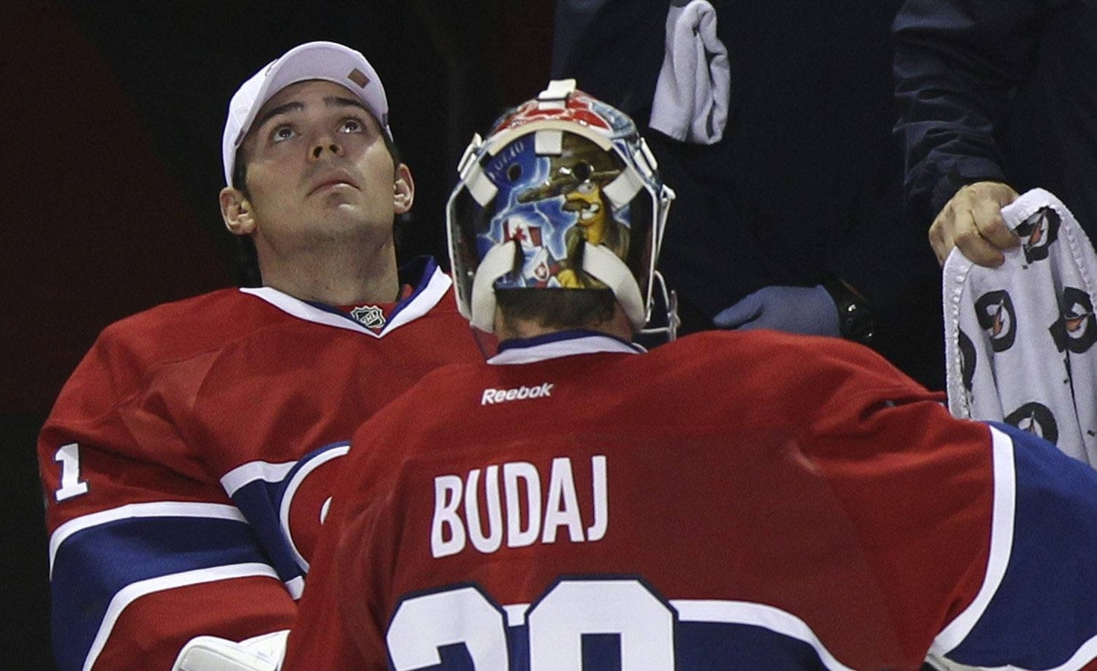 Montreal Canadiens goalie Carey Price (L) looks at the scoreboard as goalie Peter Budaj (30) skates to the bench during a break in play in third period NHL hockey action against the Florida Panthers in Montreal, October 24, 2011.