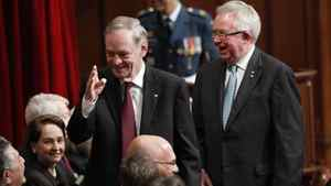 Former Canadian prime ministers Jean Chretien, left, and Joe Clark, right, attend a ceremony as David Johnston is sworn-in as Canada's 28th Governor General in the Senate chamber on Parliament Hill in Ottawa Oct. 1, 2010.