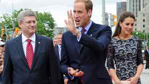 Prime Minister Stephen Harper arrives at the National War Memorial in Ottawa with Prince William and the Duchess of Cambridge on June 30, 2011.