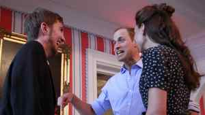 Britain's Prince William (C) and his wife Catherine, Duchess of Cambridge, take part in a youth reception at Rideau Hall in Ottawa June 30, 2011.