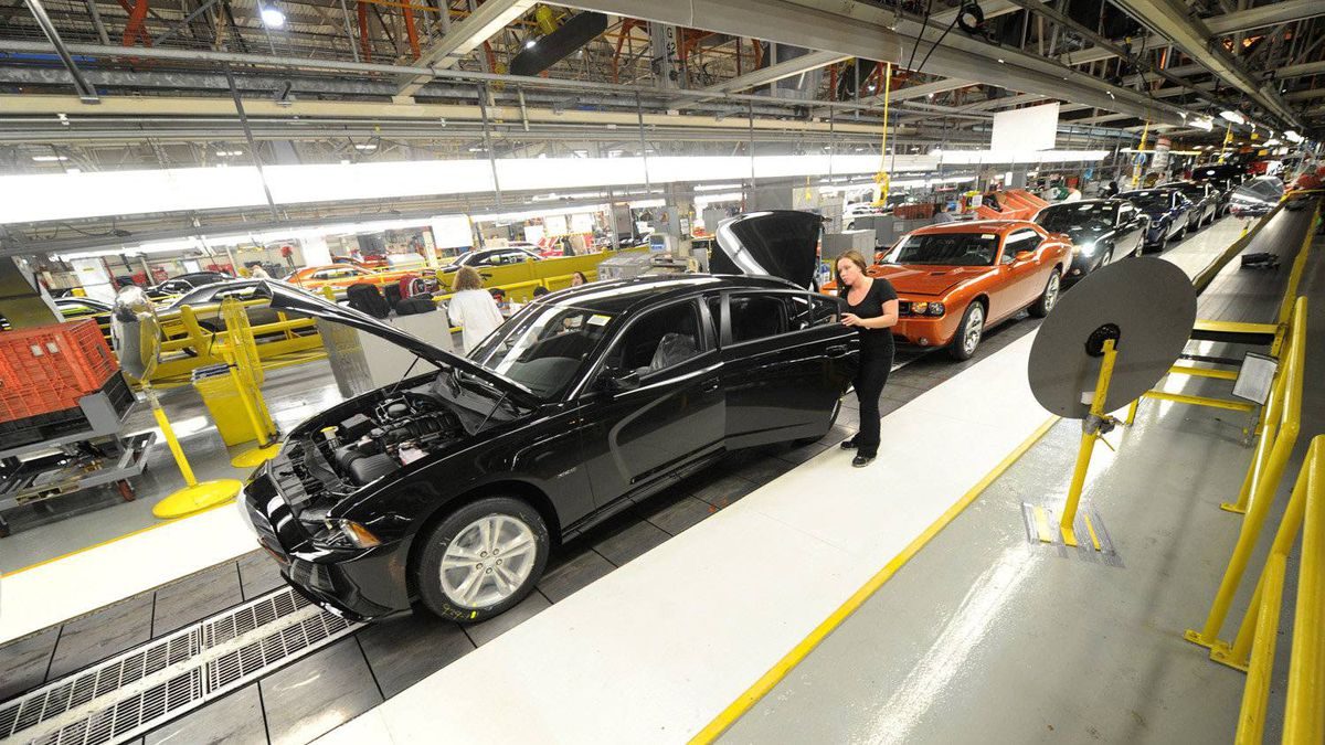 Chrysler employees assemble cars at the plant in Brampton, Ont. The facility makes full-sized sedans, which are losing market share in North America to fuel-efficient compact cars.