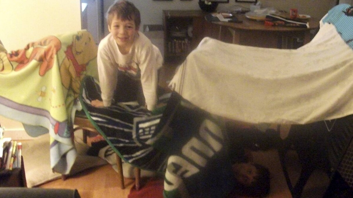 Mary Frances Hill photo: Two goofballs and their - On a typical playdate, my son Lucas and his friend build a snazzy living room fort with a hockey net, four kitchen chairs, a bedsheet and four flannel blankets.