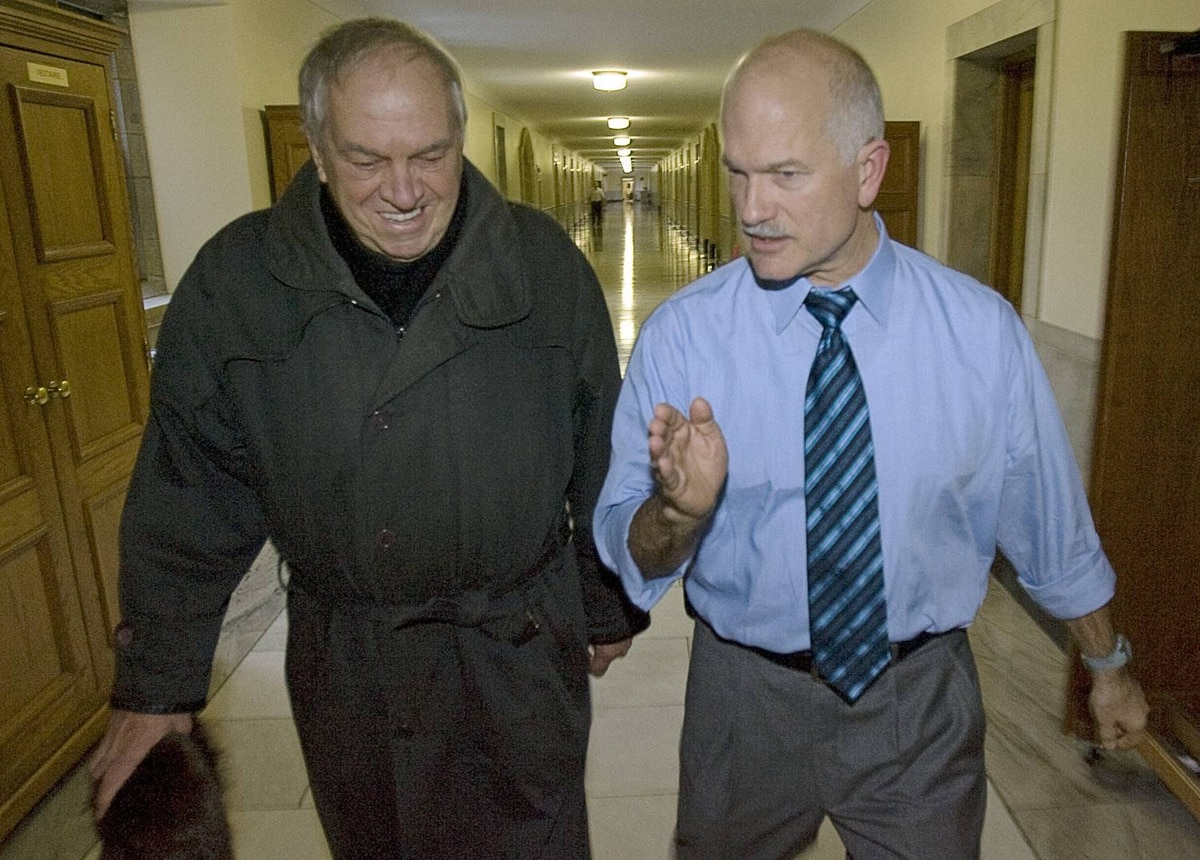 Party stalwart Ed Broadbent chats with NDP Leader Jack Layton as they leave his Parliament Hill office on Friday, November 28, 2008.