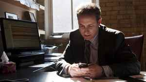 Business consultant Mark Satov uses a mobile device at his Toronto office. He has used social media and mobile devices to make him a more efficient leader.