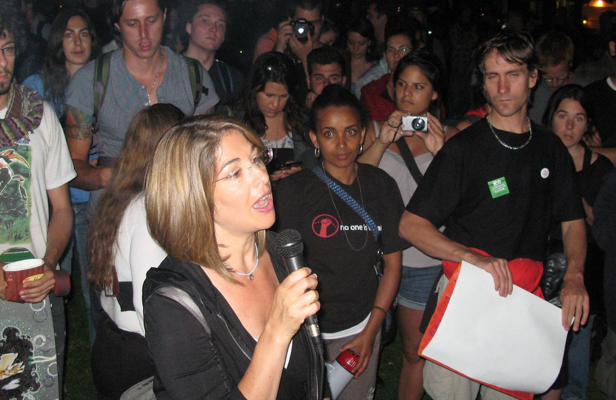 """Celebrity author Naomi Klein tells a crowd at Allan Gardens that the police """"didn't expect a bunch of middle-class people who paid $20"""" for a ticket to the event to start a march in the middle of the night."""