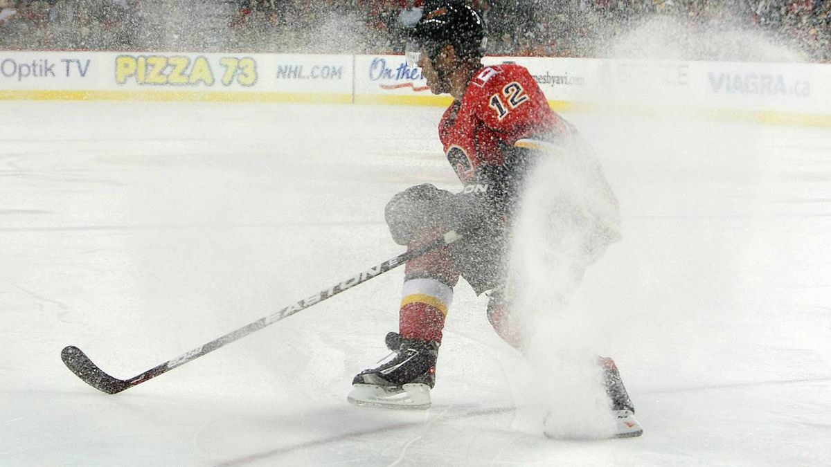 Jarome Iginla #12 of the Calgary Flames stops as ice sprays up while facing the Boston Bruins during their NHL game at Scotiabank Saddledome, February 22,2011 in Calgary, Alberta, Canada. The Bruins won 3-1. (Photo By Dave Sandford/Getty Images)