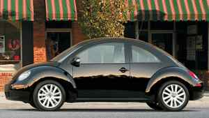 """The 2009 Volkswagen """"New Beetle,"""" which is now the older model compared to the 2012 Beetle."""