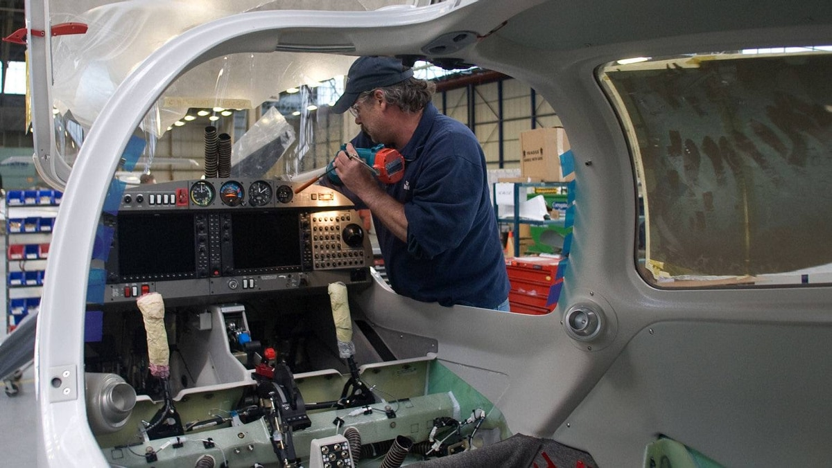 Rick Letness inspects the installation of an instrument panel. The company's twin enginefour seater DA42 starts at $624,500 and the D-JET model at $1.89 million.