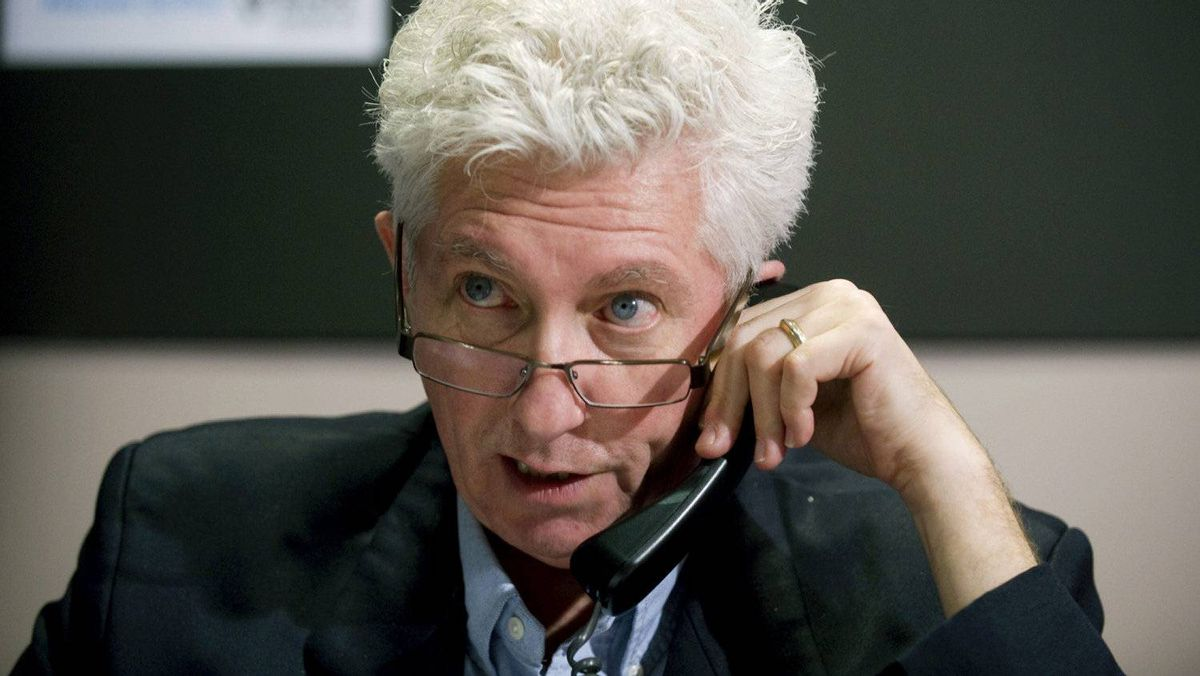 Bloc Qu�b�cois Leader Gilles Duceppe speaks on the phone to a Bloc supporter during a May 2nd federal election campaign stop in Montreal, Saturday, April 23, 2011.