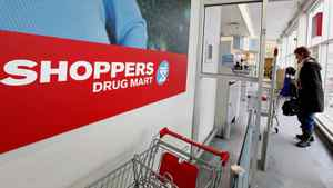 A customer enters a Shoppers Drug Mart in Toronto on Feb. 7, 2011.