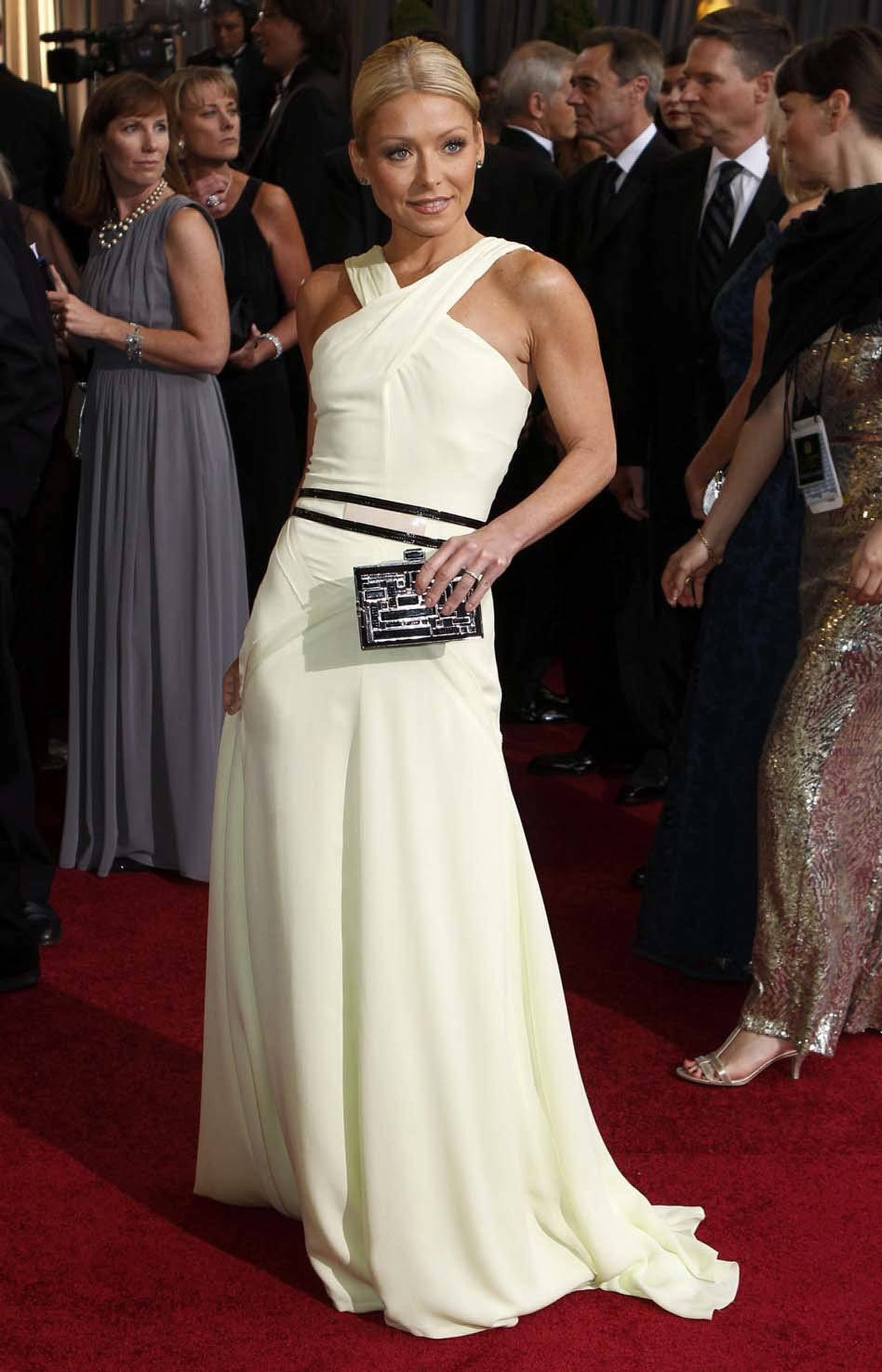 Talk show host Kelly Ripa, or what's left of her, poses on the Oscars red carpet on Sunday.