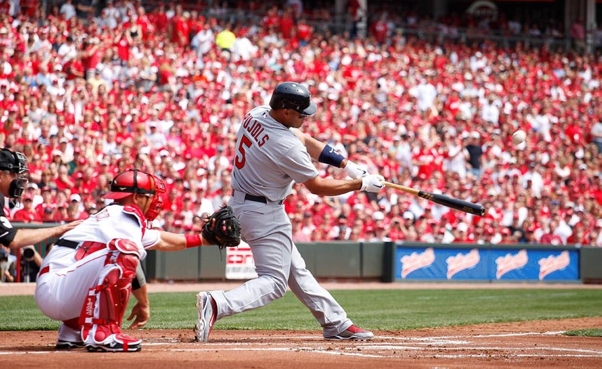 Albert Pujols #5 of the St. Louis Cardinals hits a home run in the first inning against the Cincinnati Reds at the Great American Ball Park on March 5, 2010 in Cincinnati, Ohio.