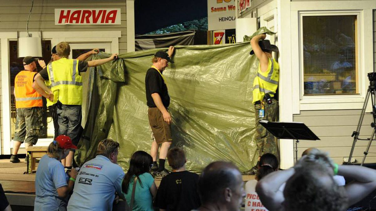 The sauna and the final two competitors - Finland's Timo Kaukonen and Russia's Vladimir Ladyzhenskiy - are shielded by a tarpaulin at the final at the World Sauna Championships in Heinola, Finland, on Saturday, Aug. 7, 2010.