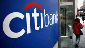 A customer exits a Citibank branch at 40th St. and Broadway in New York Tuesday, Nov. 25, 2008.
