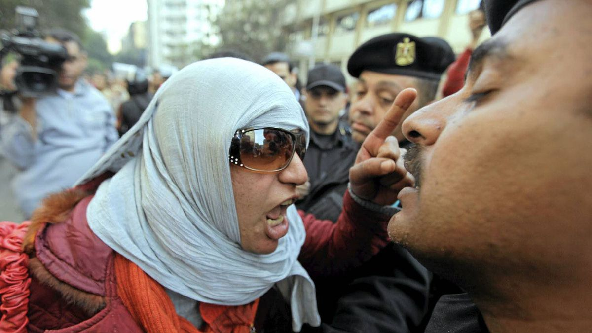 Angry Egyptian activist shouts at anti-riot policemen who block the way leading to journalists syndicate in downtown Cairo, Egypt, Wednesday, Jan. 26, 2011. A small gathering of Egyptian anti-government activists tried to stage a second day of protests in Cairo Wednesday in defiance of a ban on any gatherings, but police quickly moved in and used force to disperse the group.