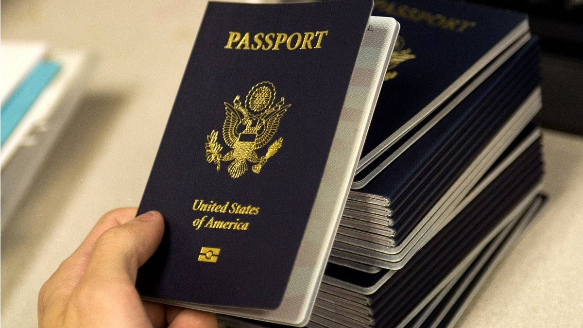 A U.S. government official holds one of several passports embedded with electronics chips intended to make them more secure and harder to forge.