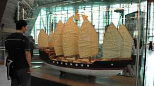 A man looks at a replica of a 15th-century treasure ship used by legendary Chinese explorer Admiral Zheng He at the new maritime museum in Singapore.