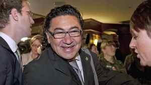 Romeo Saganash, the MP for Abitibi-Baie-James-Nunavik-Eeyou, makes his way through a crowd of reporters upon arriving to an NDP caucus meeting on Sept. 14, 2011 in Quebec City.