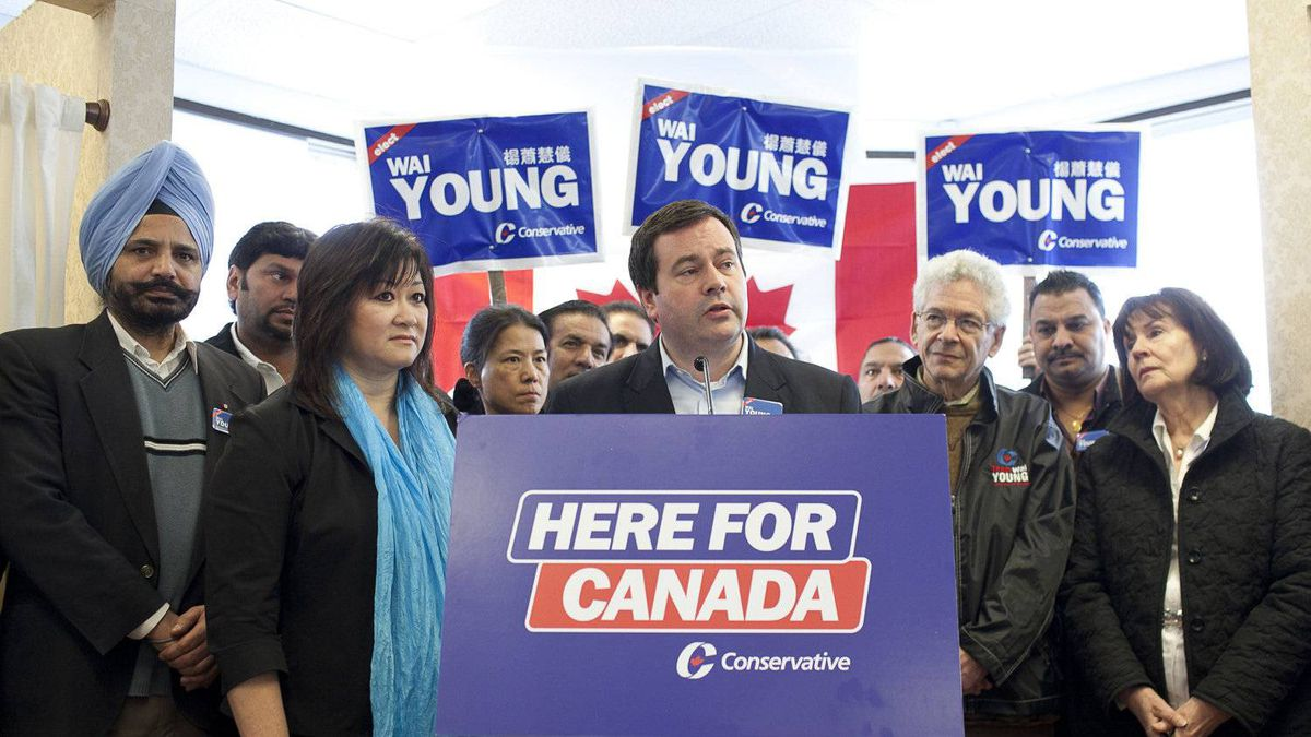 Conservative MP and Minister Jason Kenney speaks to media Wednesday in the campaign office of Vancouver South Conservative candidate Wai Young.