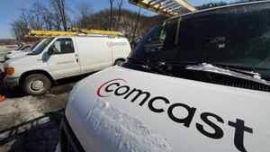This Feb. 13, 2012 photo, shows Comcast service vehicles parked at a Comcast facility in Pittsburgh.