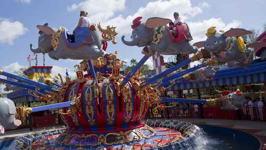 Guests take a spin on the Dumbo the Flying Elephant ride on March 12, 2012. The first part of the attraction features Dumbo spinning clockwise for the first time in Magic Kingdom history.