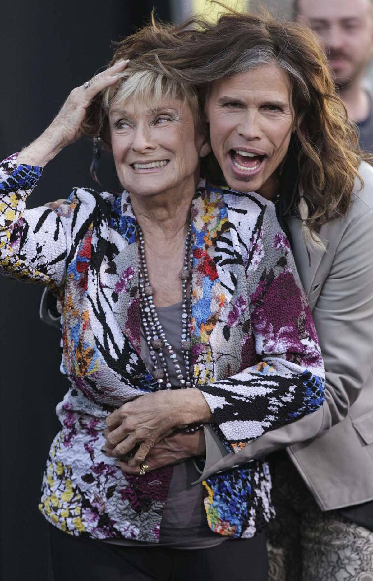 "A triumphant Steven Tyler tries to hang Cloris Leachman around his neck at the premiere of ""Dark Shadows"" in Hollywood on Monday."