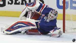 New York Rangers goalie Henrik Lundqvist makes a save against the Washington Capitals during the first period in Game 7 of their NHL Eastern Conference semi-final playoff hockey game at Madison Square Garden in New York May 12, 2012. REUTERS/Ray Stubblebine