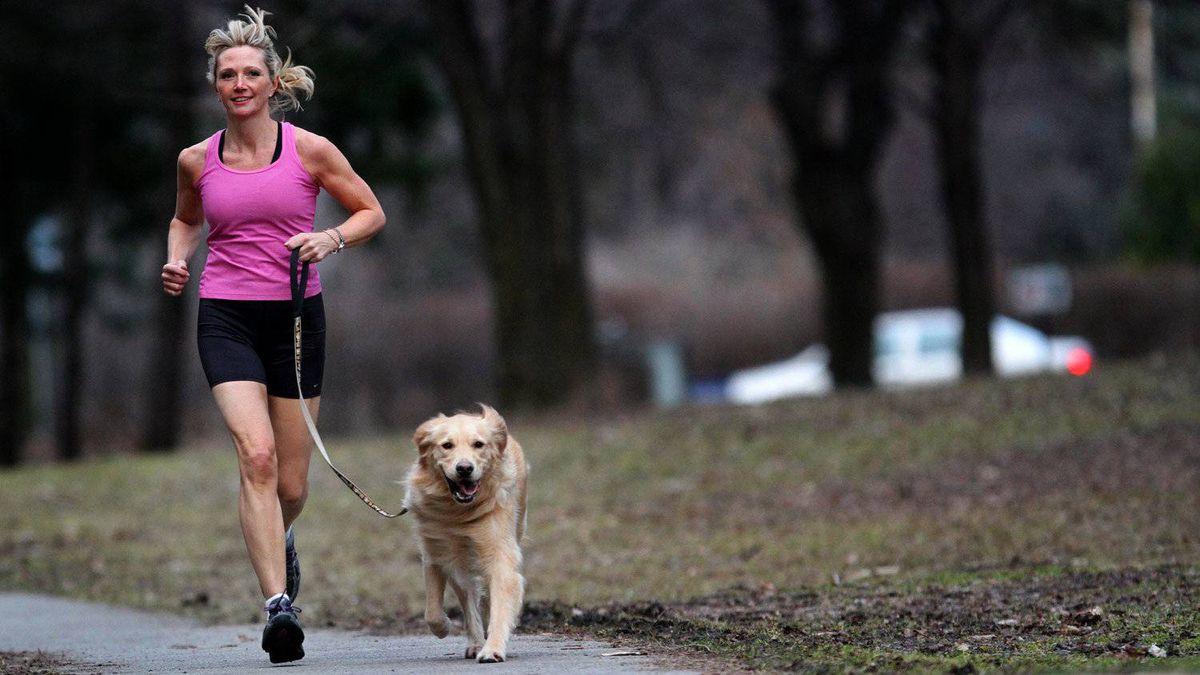 Kerry Mitchell jogs with her golden retriever, Dutch.