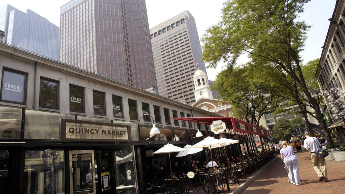 Shoppers stroll through Faneuil Hall Marketplace in Boston, owned by General Growth Properties.