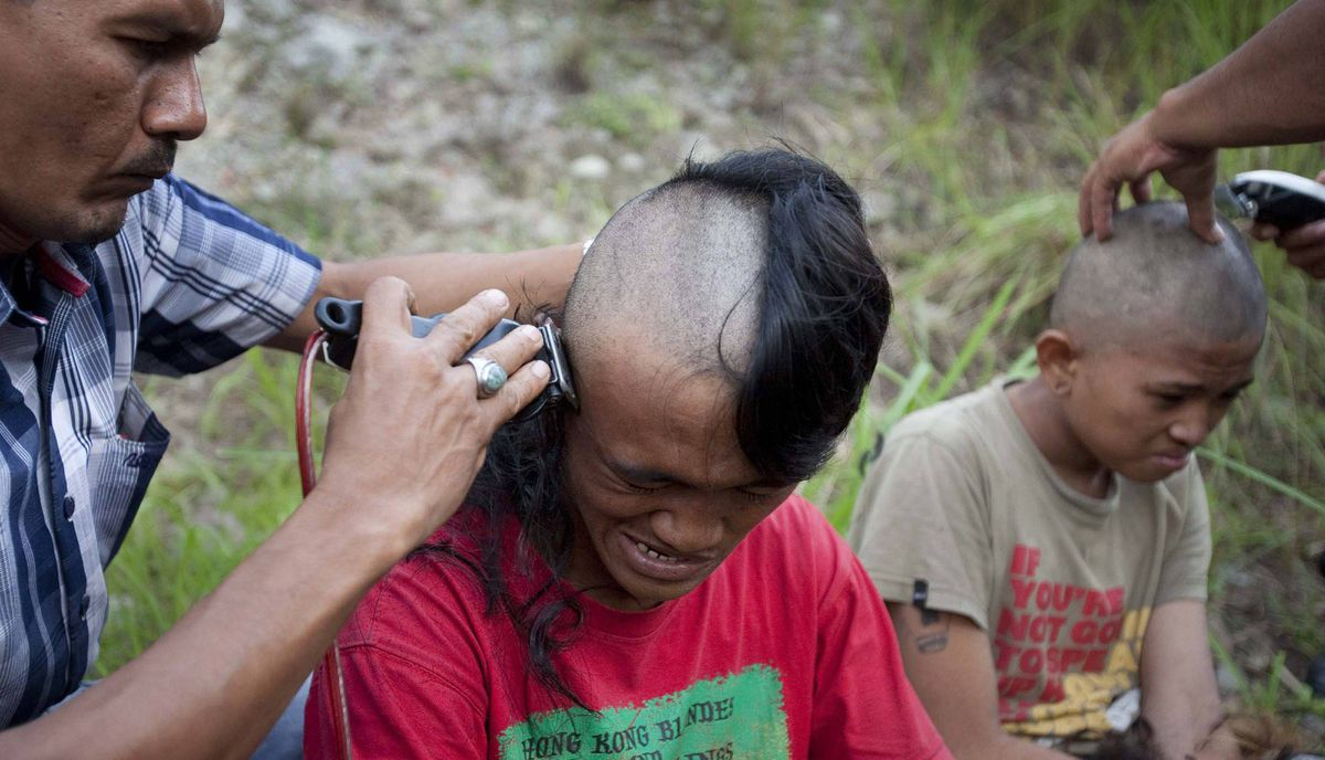 Police shave the hair of detained Indonesian punks at a police school in Aceh Besar in Aceh province.