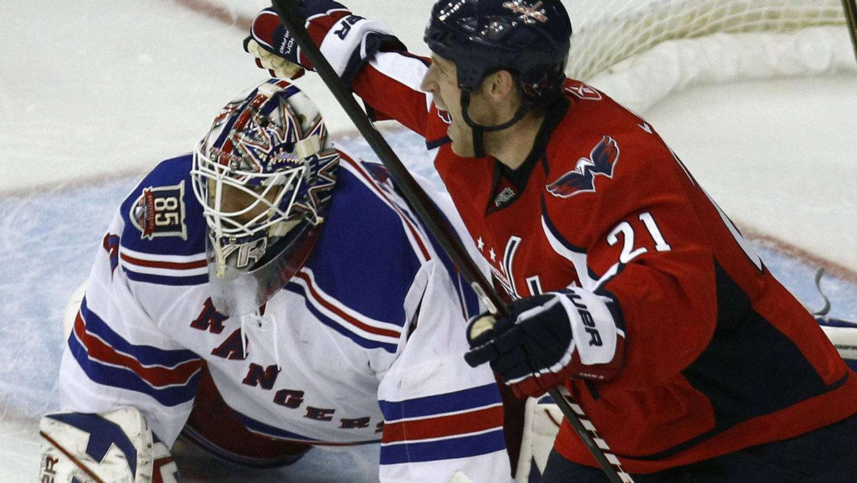 Washington Capitals' Brooks Laich (R) celebrates a goal scored by teammate Jason Chimera on New York Rangers' goalie Henrik Lundqvist. REUTERS/Jim Young