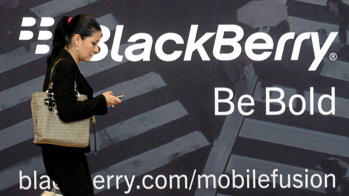 A woman uses her mobile phone at the Blackberry World Event in Orlando May 1, 2012. )