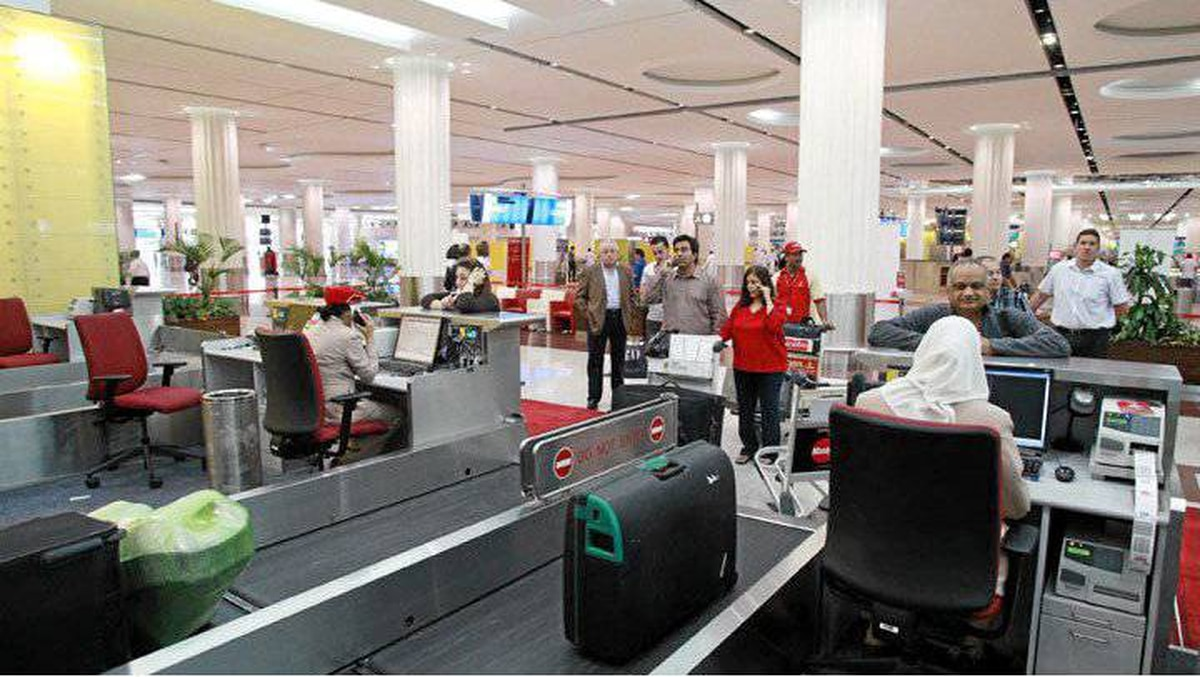 Emirates Airline passengers check-in at Dubai International Airport.
