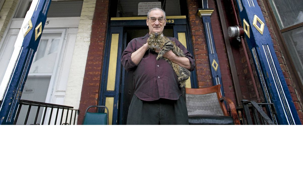 Reg Hartt, who runs The Cineforum, is photographed with his cat Berlin at his home in Toronto on Feb. 24, 2012.